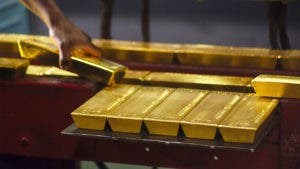 Person setting down gold bars