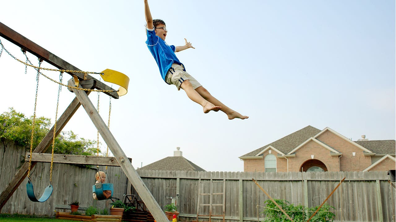 Kid jumping out of swing set