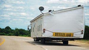 Truck towing a modular home