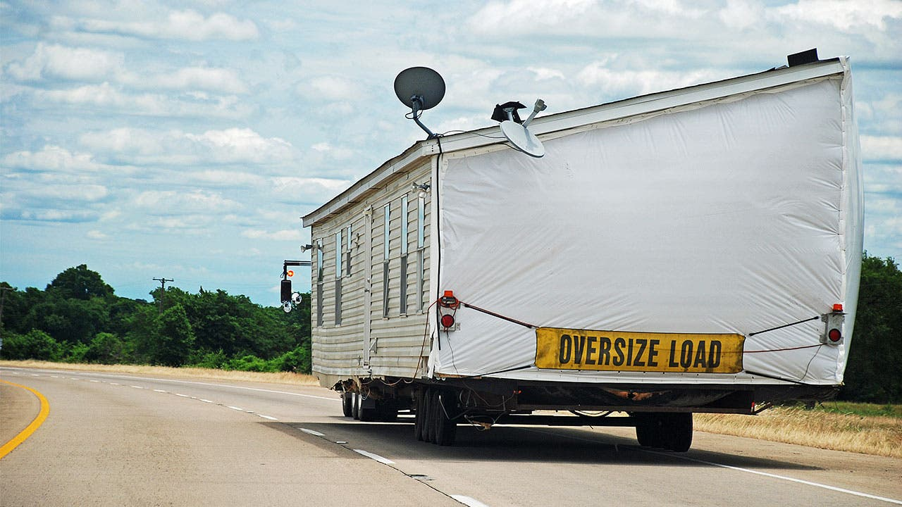 Truck towing a modular home