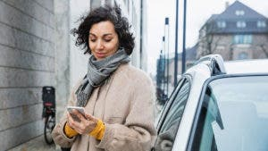 Woman using app on phone outside