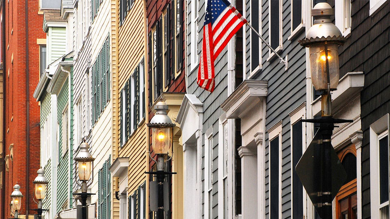 Row of townhouses with an American flag