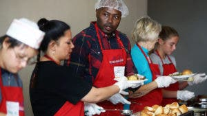 Americans volunteering in a soup kitchen on Thanksgiving