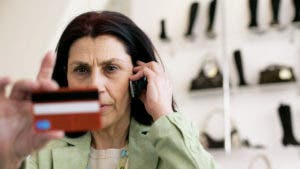 Woman reading the numbers on her credit card