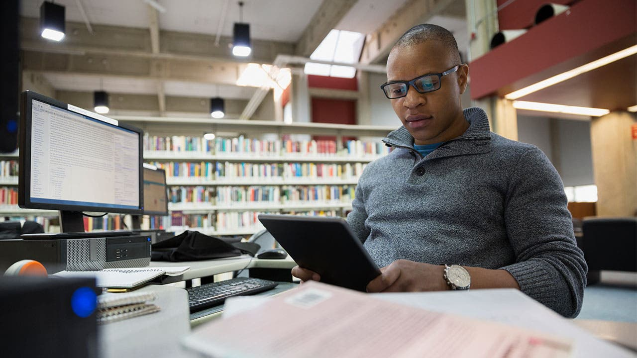 Man in library studying
