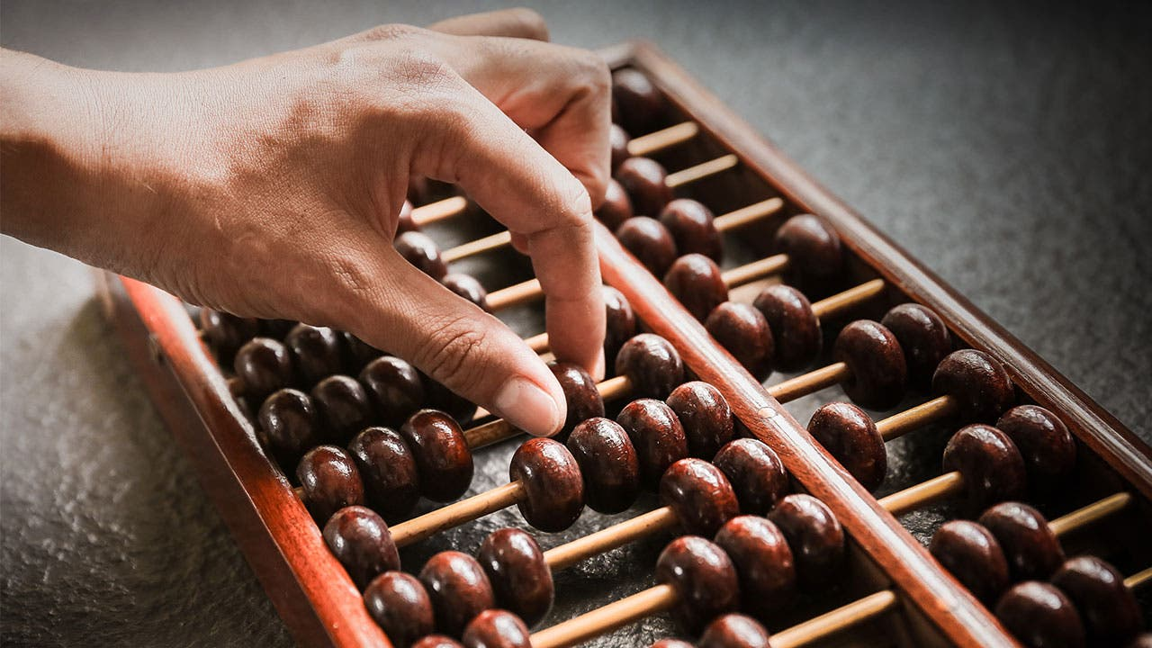 Woman moving abacus