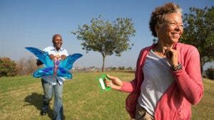 Man and woman trying to fly a kite