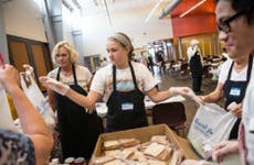 Volunteers packing lunches for charity