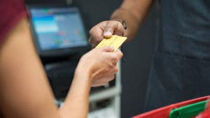 Credit card changing hands at point of sale
