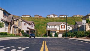 Suburban neighborhood with homes on a street and hill