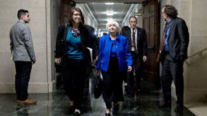 Janet Yellen Fed Chair walking in Fed building