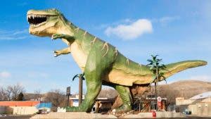Tyrannosaurus rex laying waste to tiny desert community