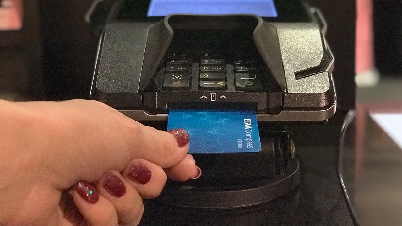Woman inserting credit card