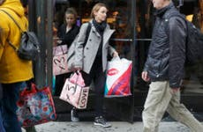 Christmas shopping leave store with shopping bags