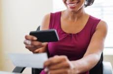 Woman depositing a check via her smartphone