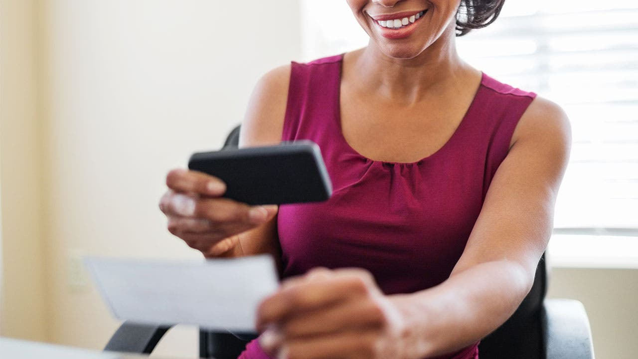 Woman depositing a check via her smartphone