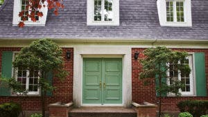 Front of a home with green door