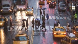Pedestrians walking across the street in New York