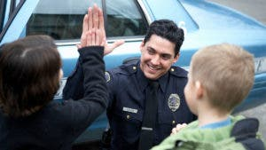 Policeman giving kid high five