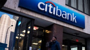man walking by Citi Bank