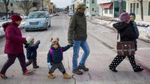Family crosses the street in rural America