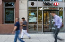 People walking past an HSBC Bank