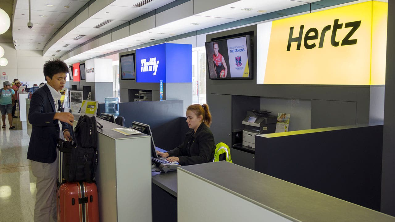 Man renting a car at Hertz