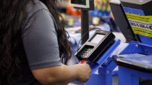 Man using debit card at Walmart
