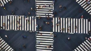 Aerial view of people walking crosswalk