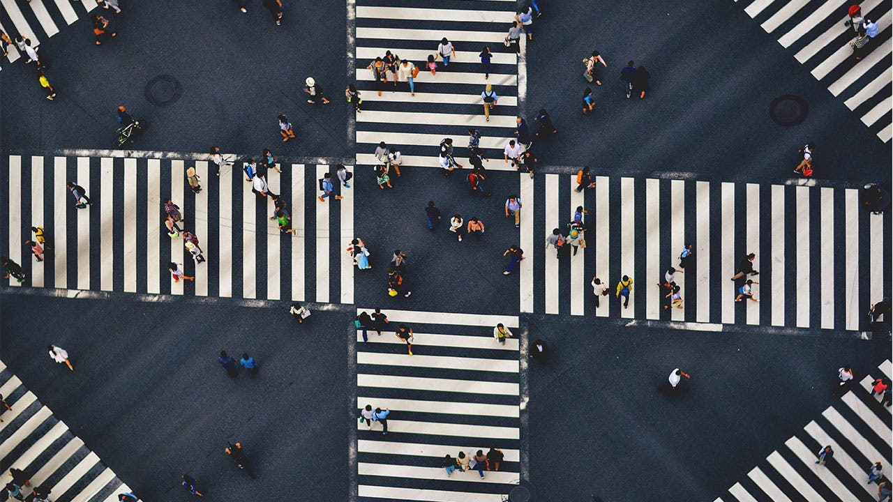 Aerial view of people walking crosswalk