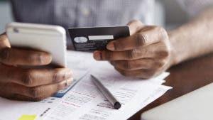 man paying his credit card bill