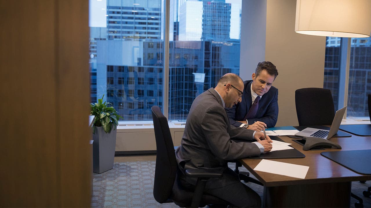 lawyer and client completing paperwork