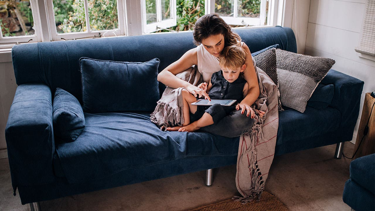 Mother and son on couch