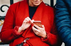 Woman in rd coat texting