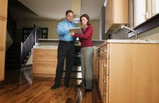 Relator with prospective home buyer