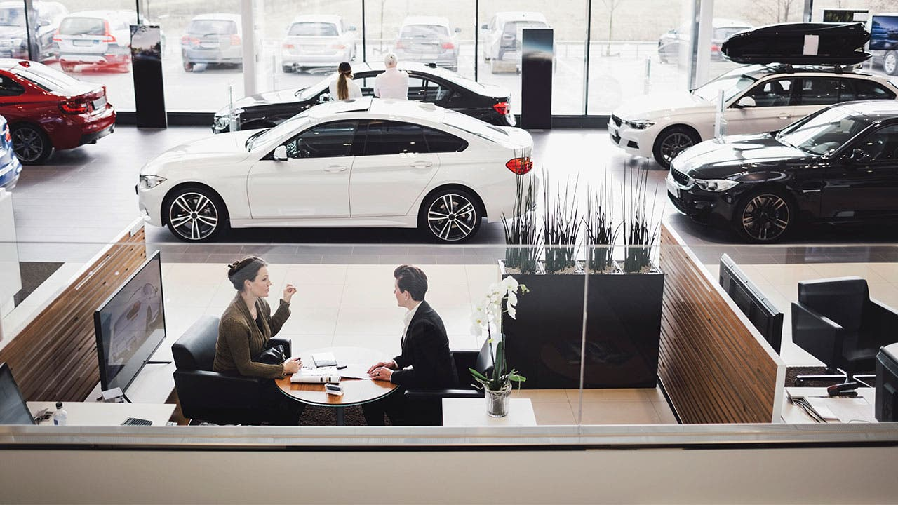 Woman financing a car in a dealership
