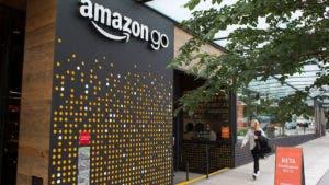 Woman walking past Amazongo store in Seattle
