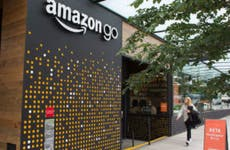 Woman walking past Amazongo store in Seattle