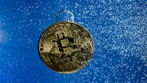 Bitcoin falling into water
