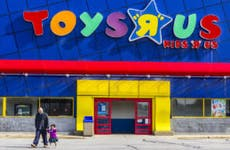 Father and child leaving Toys R Us