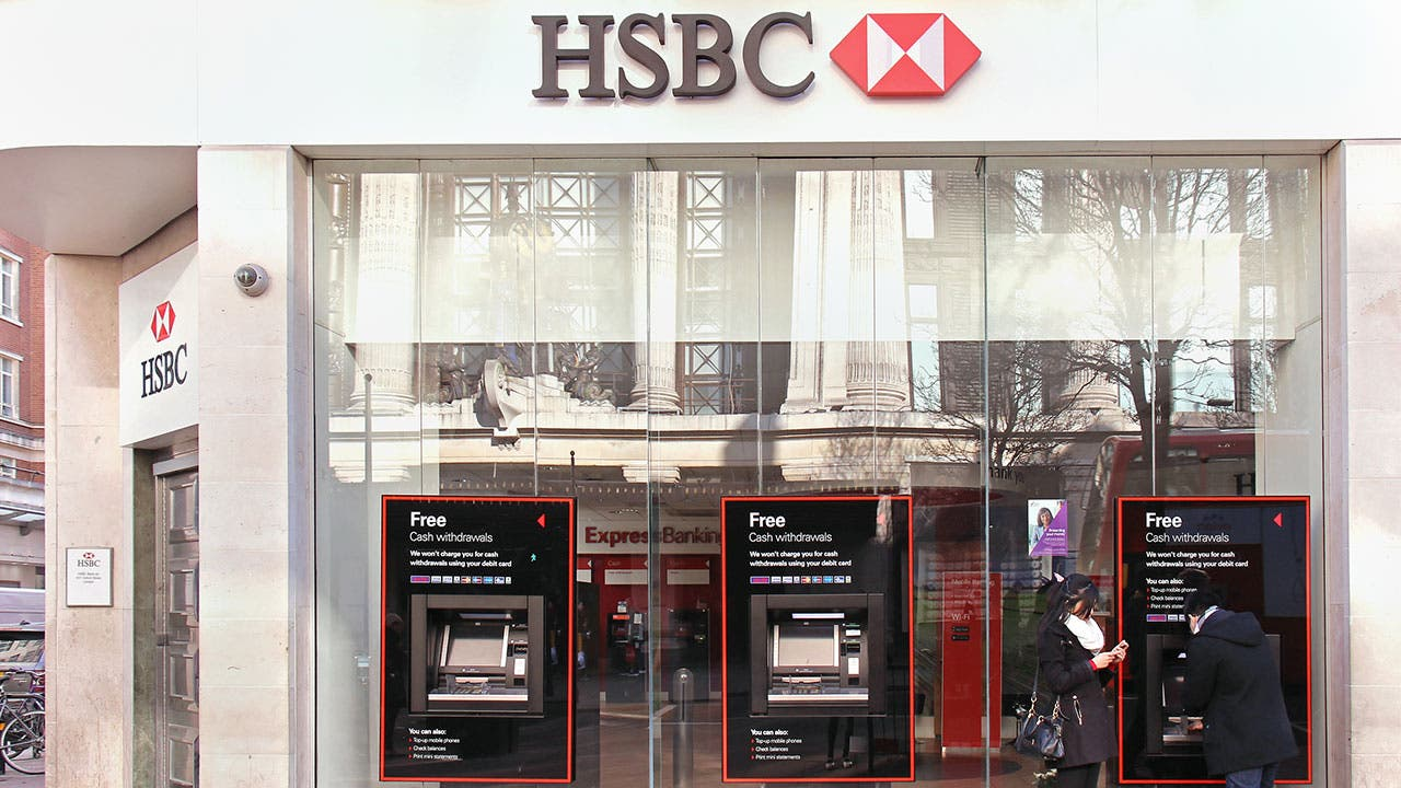 Couple at atm at a HSBC bank branch