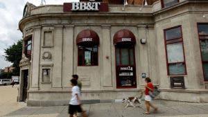 People walking past BB&T bank branch