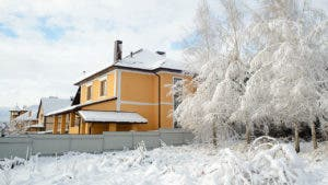 Yellow house on a snowy day