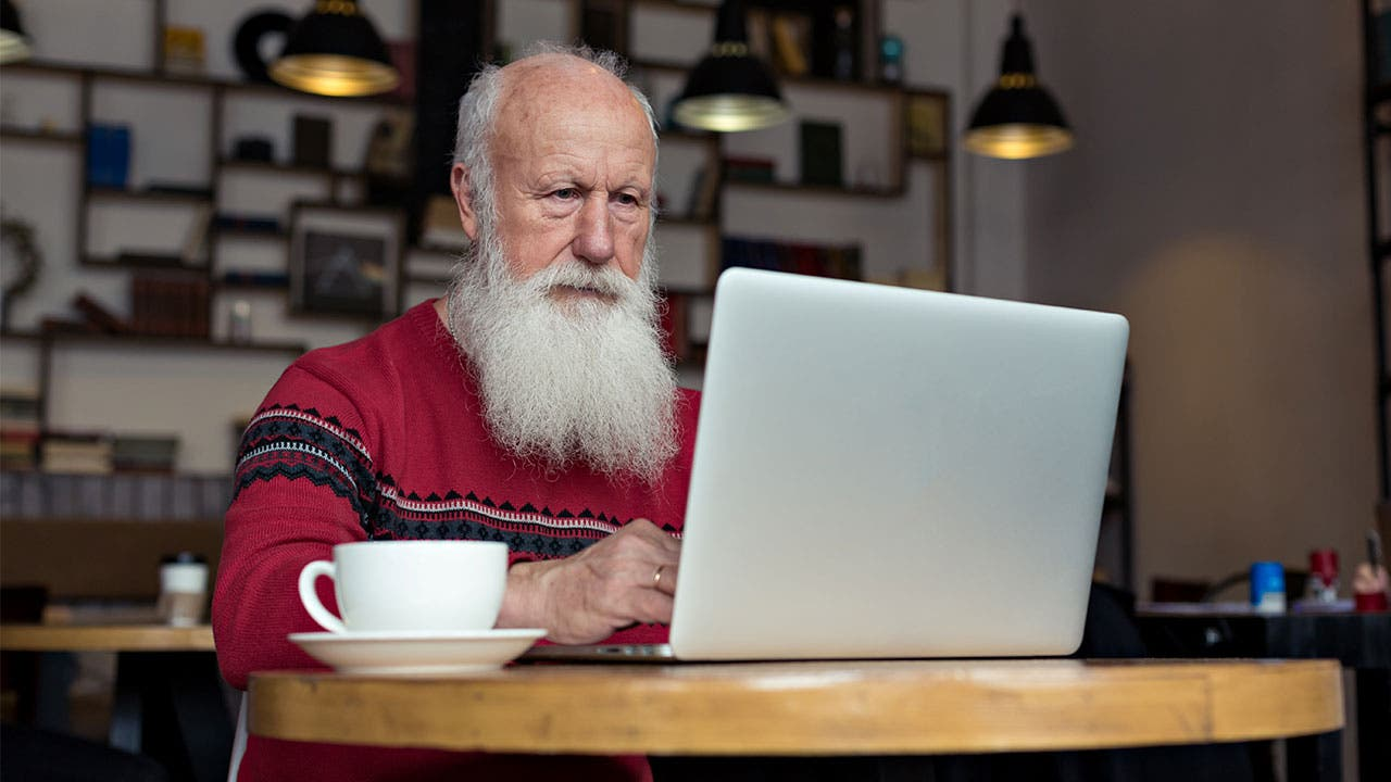 Older man working on computer