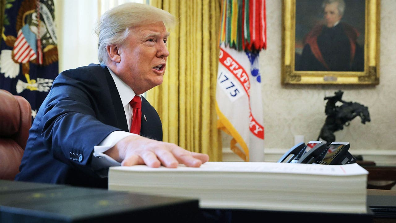 President Trump with tax reform documents