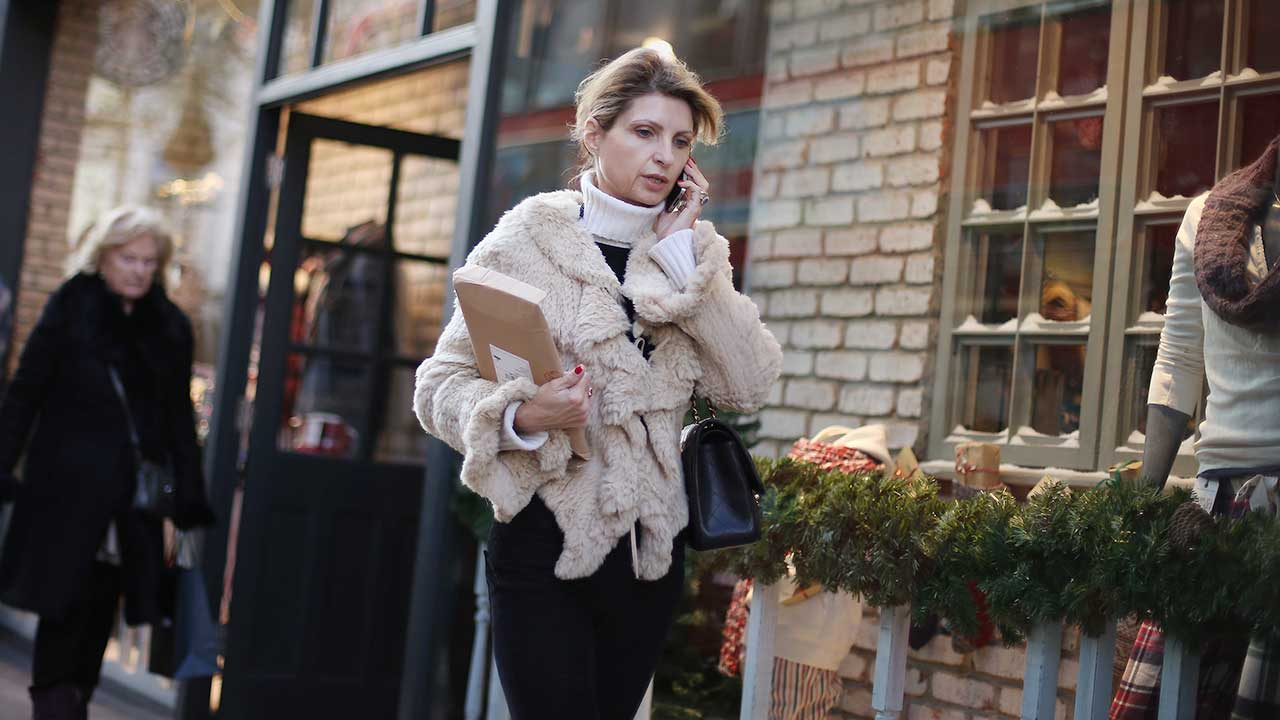Woman on phone, walking