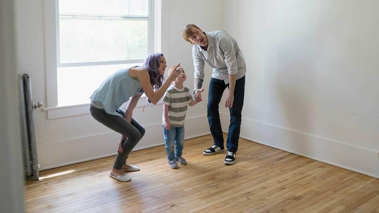 Young family in empty new house