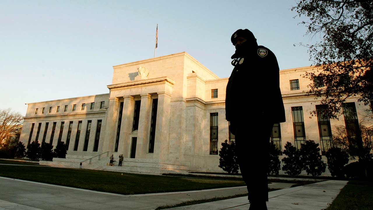 Guard standing in front of Federal Reserve building