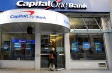 Woman entering a CaptiolOne Bank