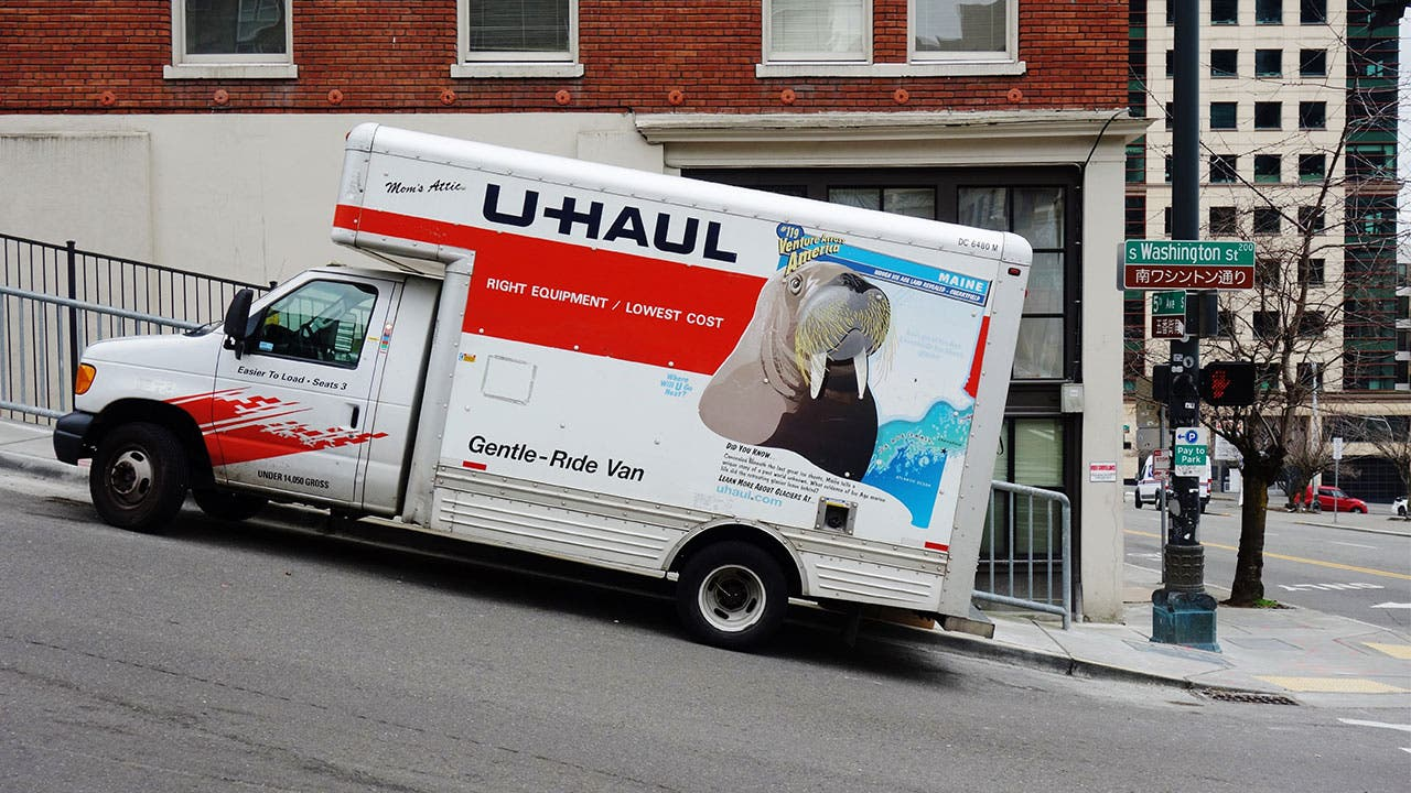 UHaul truck parked on hill